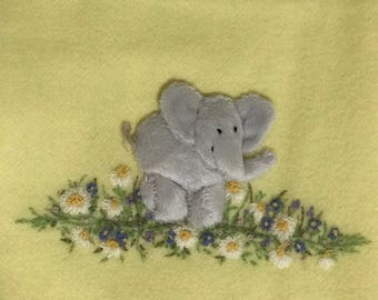 Soft woollen baby blanket, backed with satin binding - elephant