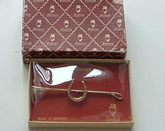 Boxed Stratton equestrian tie retainer