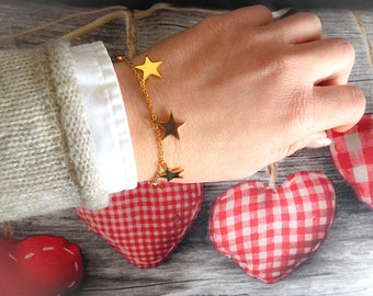 Golden bracelet with star pendants
