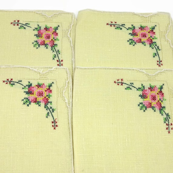 4 vintage embroidered napkins, yellow linen, luncheon size, cross stitched flowers and faggotted edge, mid 20th century, 11 inches square