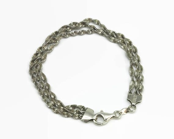 Sterling silver bracelet with 3 separate twisted herringbone chains, stamped Italy and 925, parrot beak closure,