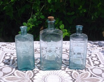 Three Antique Pale Blue Glass Bottles. 1900's.