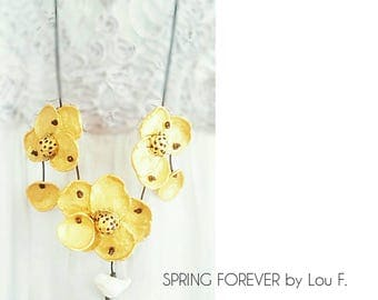 Beautiful necklace, golden flowers, white bird