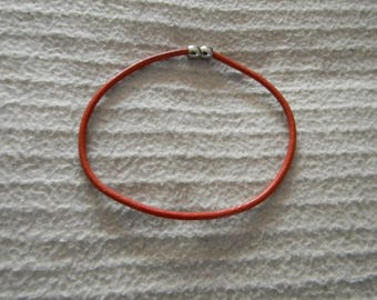 Leather cord bracelet orange closure ball