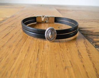 Oval from black leather bracelet