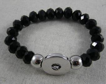 Bracelet élastique de perles noires à facettes