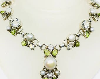 Pearl, peridot, crystal quartz multistone necklaces set in sterling silver 925. All stones are natural and authentic. Adjustable length.