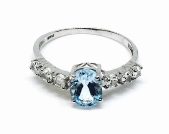 10% Bluetopaz and white topaz ring  set in Sterling silver 925. Size -9. Natural authentic stones.
