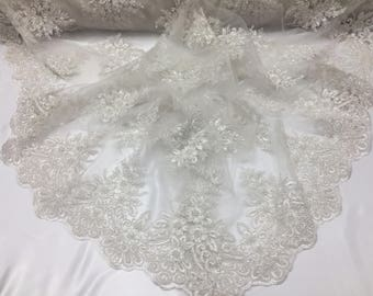Uniquely designed beaded mesh lace Bridal Wedding fabric ivory. Sold By Yard