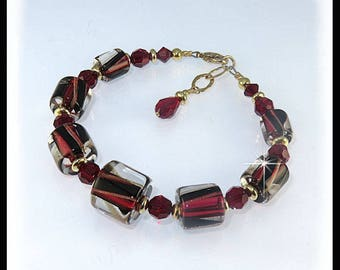 Black and red bracelet with gold filled beads, David Christensen glass beads, red and black bracelet, gold bracelet, red, black and gold,