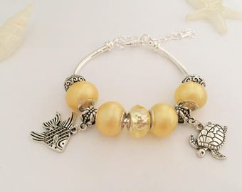 Yellow charms bracelet with charms, holiday ref 531 series