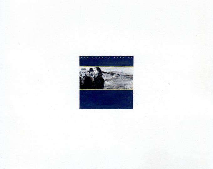 "Print of miniature painting of U2 Joshua Tree Album. 1 1/4""x1 1/4"" print of original U2 painting on 5"" square german etching paper"