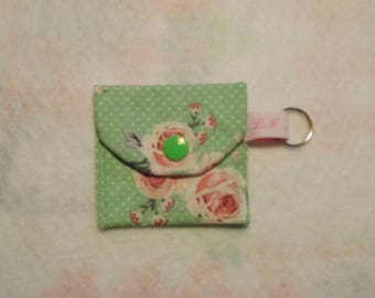 Mini coin purse or token holder, key chain.