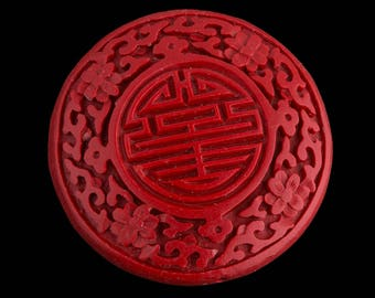Carved red cinnabar disk. 55mm pkg of 1. B7-CIN017(e)