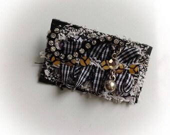 Brooch, textile, rectangle, black, white art