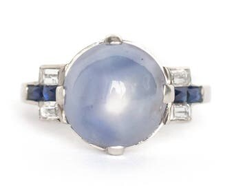 Circa 1930s Art Deco Platinum 7.25ct Cabochon Star Sapphire Engagement Ring with Side Diamonds and Sapphires - VEG#844