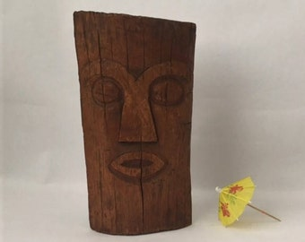 vintage carved wooden head, tiki boho tribal global style, primitive Easter Island abstract detail, beach bar decor, a little modern glam