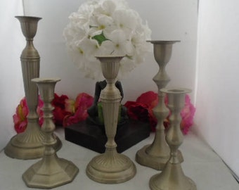 Vintage Set of Five Silvertone Candle Holders. None of them are the same Height on Purpose. Two out of the Three are Missing Velvet Bottoms.