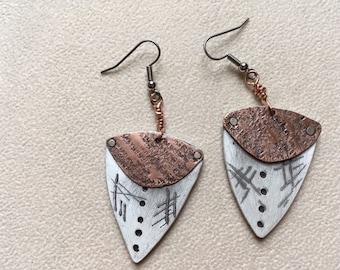 Copper and faux bone shield shape dangle earrings.