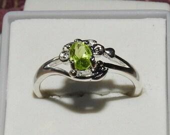 Pakistani Peridot .50 TCW 6 x 4 MM 925 Sterling Silver Ring Ladies Size 8