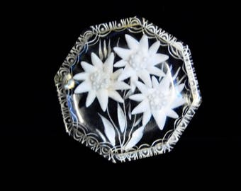 Reverse carved lucite brooch--clear with white flowers