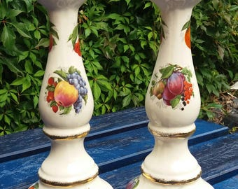 unusual tall pottery candlesticks with fruit design