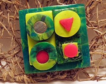Brooch. Square brooch in rainforest pattern and fluro colours. Four square brooch with fluro circles.
