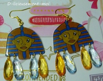 Earrings gold plated Egyptian Pharaoh Sphinx made of plastic crazy mad and drops faceted Golden blue