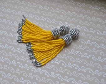 Long yellow beaded tassel clips,Oscar de la Renta , Long earrings,long earrings,long beaded tassels, beaded earrings,beaded tassel earrings