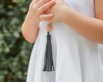Girls black leather tassel necklace with small wool felt pom