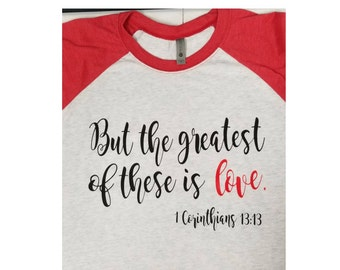 But the greatest of these is Love 3/4 sleeve Raglan Valentine's Day shirt