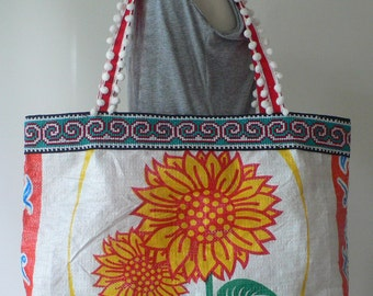 A large upcycled tote shopping bag handcrafted from a sunflower rice bag