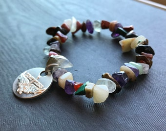 Natural gemstone chip bracelet with Official Limitless Logo tag