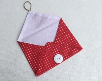 Envelope in red cloth with white dots