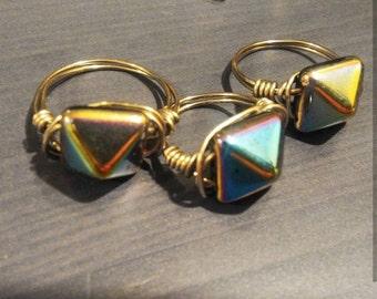 Iridescent pyramid rings