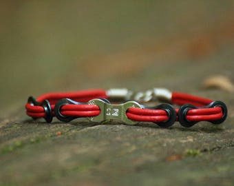 Red leather bracelet made of bike chain