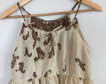 Cream and red printed crop top. High neck with frill hem. Size S