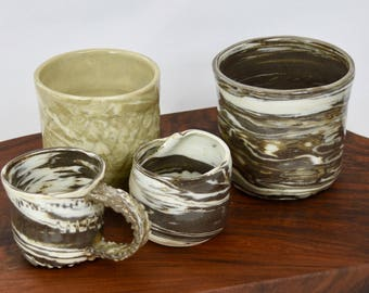Two Clay sculpted mug