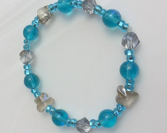 Butterfly and aqua blue beaded bracelet