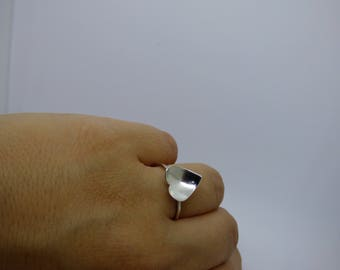 Handmade sterling silver ring with curved heart shape.