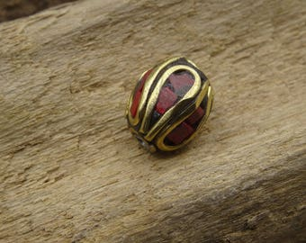 Oval coral Nepali and 11mm brass bead
