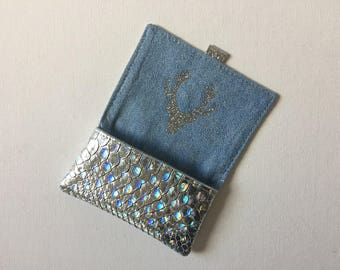 Silver holder with glitter in the inner flap gray deer head