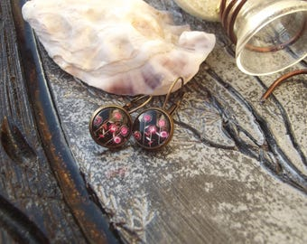 Small Stud Earrings with clasps color bronze with cabochon glass pink floral on black background