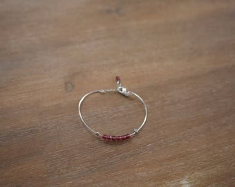 Bangle is silver with Burgundy beads