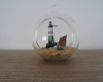 Hanging / decorative glass ball to hang or place of Ar Men and a sailboat lighthouse