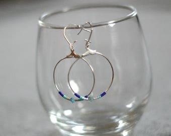 Blue, and white pearls and silver hoop earrings