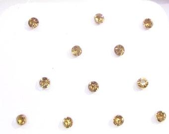 12 golden Stone Bindis Indian Bindis Sticker,Fake Nose Studs Stickers,Small Stone Stickers, Face Gems Tattoo/face art/bindi sticker