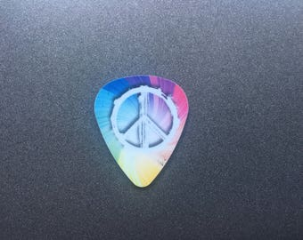 Needle Minder or Magnet: Peace Sign Swirl Guitar Pick