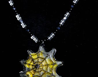 Spiderweb marigold flower pendant necklace