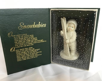"Snowbabies department 56 ""lets go skaiing"" porcelain figures"